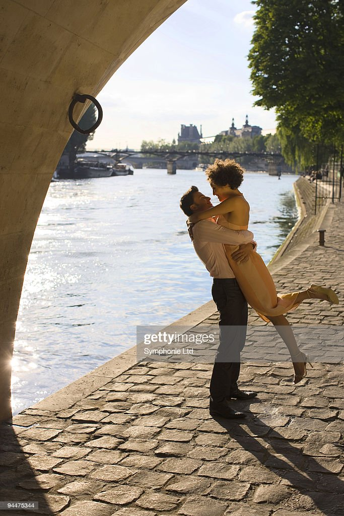 Couple hugging along river : Stock Photo