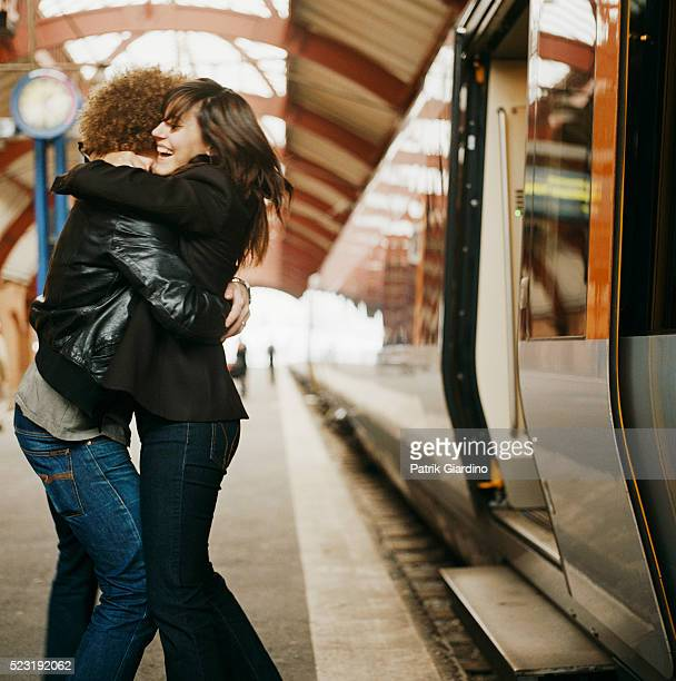 Couple Hugging at a Train Station