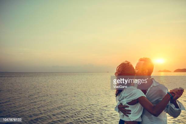 couple hugging at sunset - vladgans or gansovsky stock pictures, royalty-free photos & images