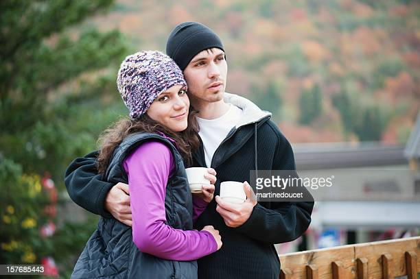 "couple hugging at the chalet. - ""martine doucet"" or martinedoucet stock pictures, royalty-free photos & images"