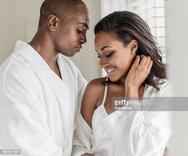 couple hugging at window - black sexual stock photos and pictures