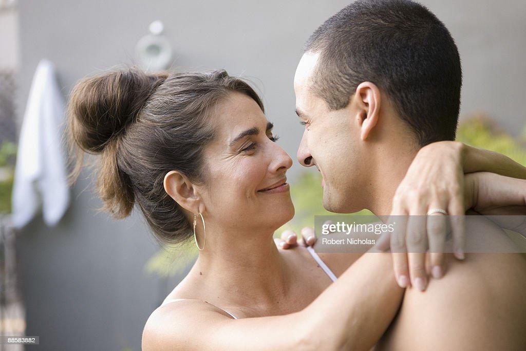 Couple hugging in backyard garden : Stock Photo