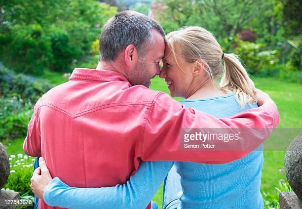 Couple hugging in backyard