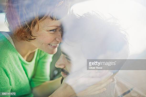 Couple hugging in car