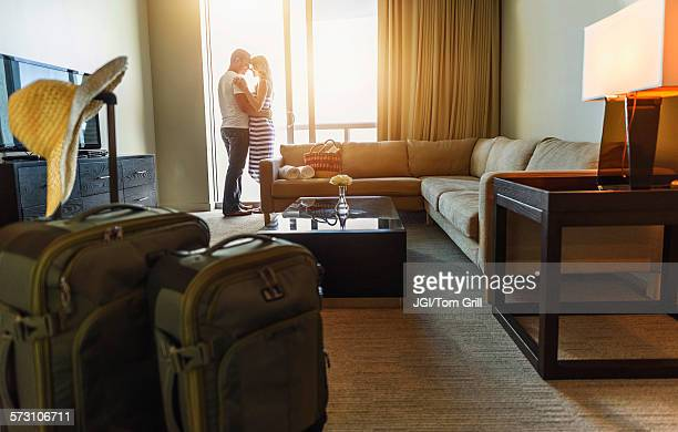 Couple hugging in hotel room