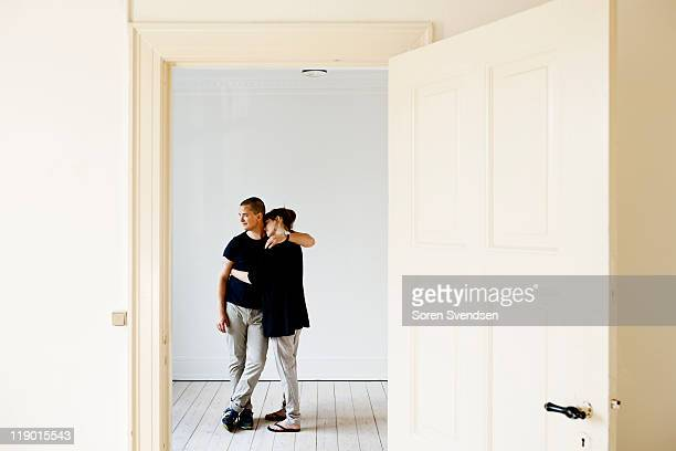 couple hugging in new home - nordic countries stock pictures, royalty-free photos & images