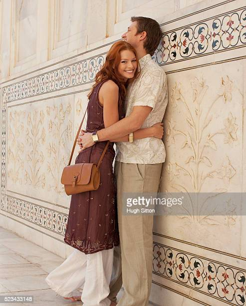 couple hugging in the taj mahal - hugh sitton stock pictures, royalty-free photos & images