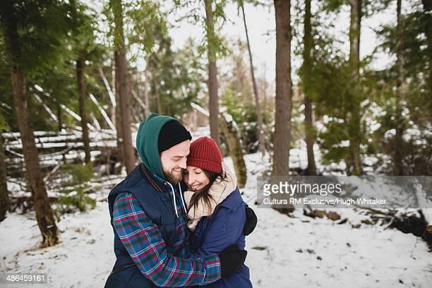 Couple hugging in woods