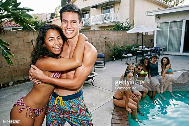 Couple hugging near swimming pool