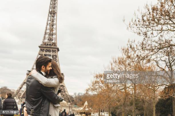 Couple hugging near the Eiffel Tower