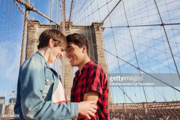 Couple hugging on Brooklyn Bridge, New York