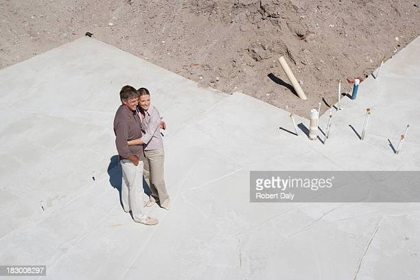 couple hugging on construction site - grounds stock pictures, royalty-free photos & images