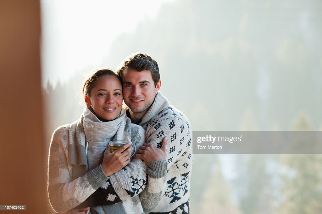 Couple hugging on patio : Stock Photo