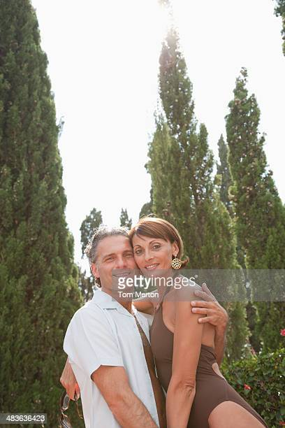 couple hugging outdoors - 50 59 years stock pictures, royalty-free photos & images