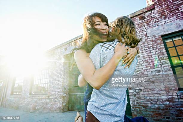 couple hugging outdoors - east asian ethnicity stock pictures, royalty-free photos & images