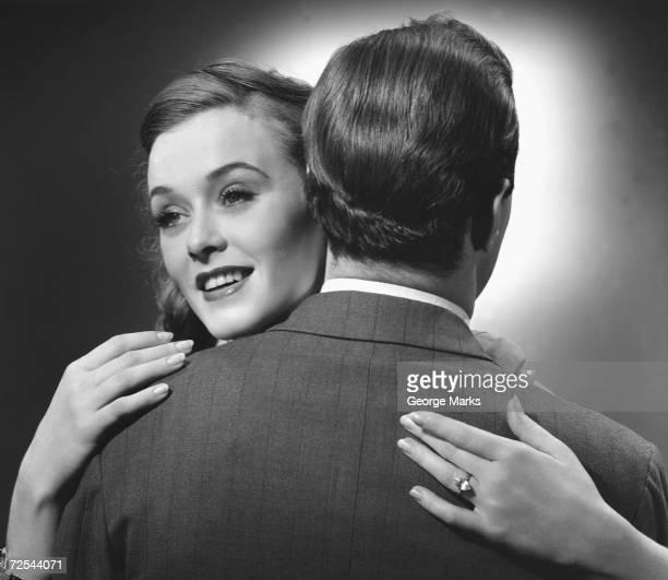 1950s: Couple hugging.