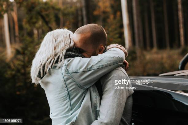 couple hugging, side view - västra götaland county stock pictures, royalty-free photos & images