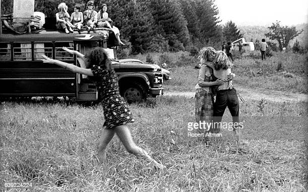 A couple hugs as a bus is shown in the background during the Alternative Media Conference at Goddard College in June 1720 1970 in Plainfield Vermont