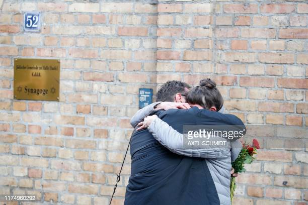 TOPSHOT A couple hugs at the synagogue in Halle eastern Germany on October 10 one day after the attack where two people were shot dead Two people...