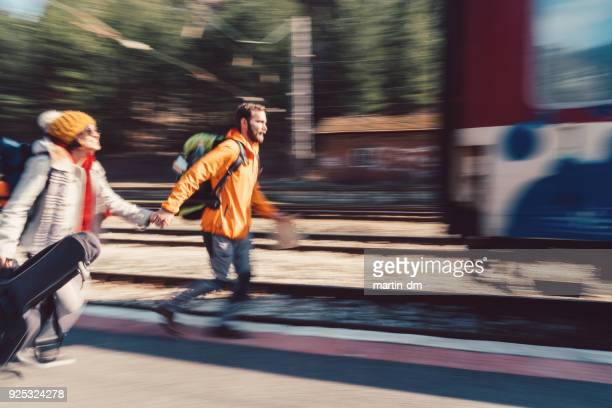 Couple hurrying to get on the train