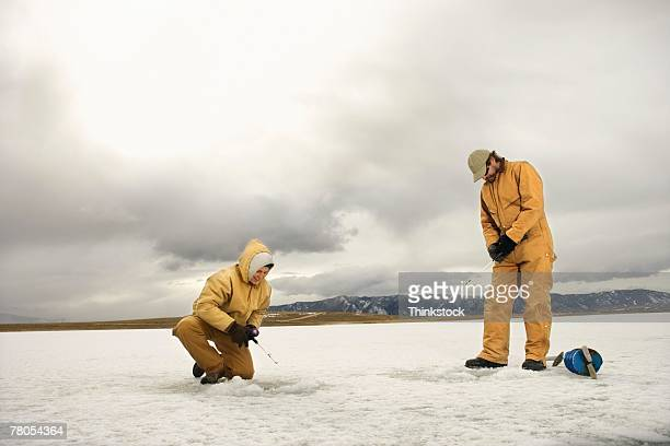 couple ice fishing - ice fishing stock pictures, royalty-free photos & images