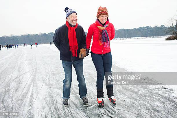 couple ice skating, holding hands - ice skate stock pictures, royalty-free photos & images