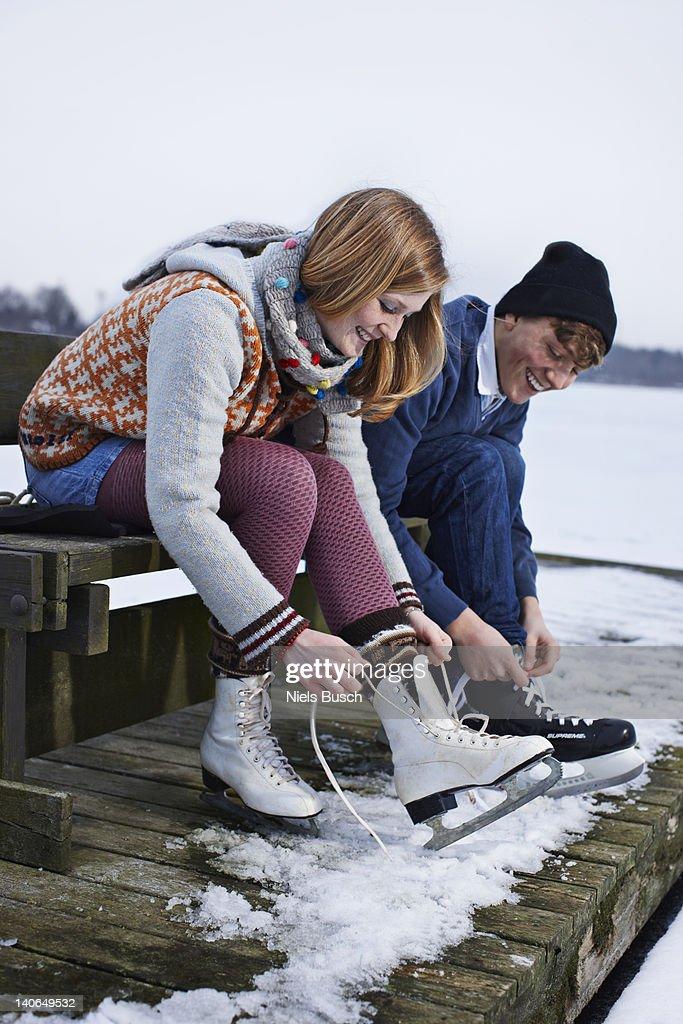 Couple ice skating on lake : Stock Photo