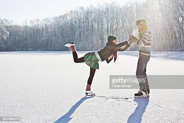 couple ice skating together - スケート ストックフォトと画像