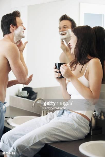 couple in a bathroom - depilazione intima foto e immagini stock
