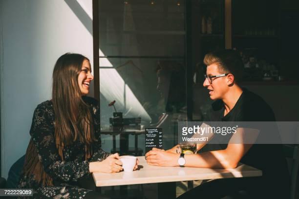 Couple in a coffee shop having fun