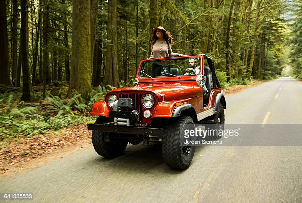 a couple in a convertible. - 4x4 stock pictures, royalty-free photos & images
