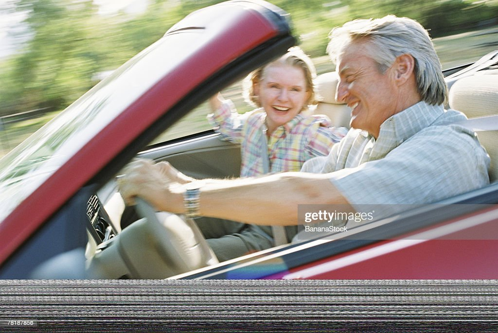 Couple in a convertible : Stock Photo