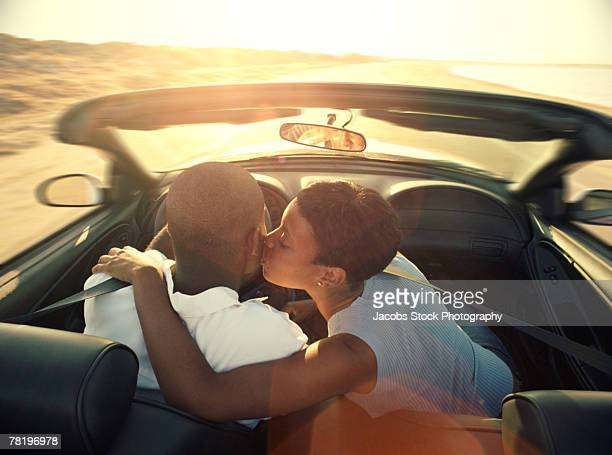 Couple in a convertible