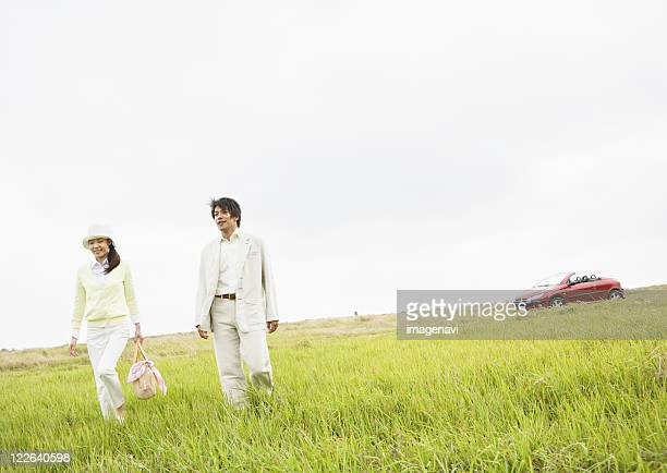 Couple in a field of grass