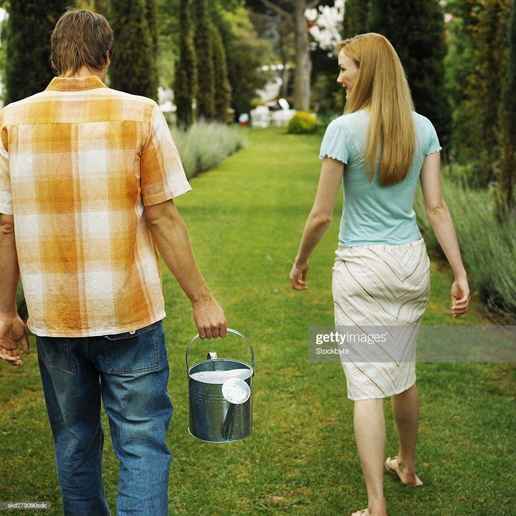 Couple in a garden : Stock Photo
