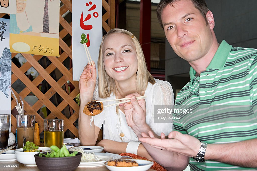 Couple in a japanese restaurant : Stock Photo