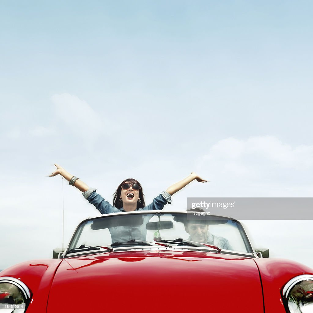 Couple in a red convertible : Stock Photo