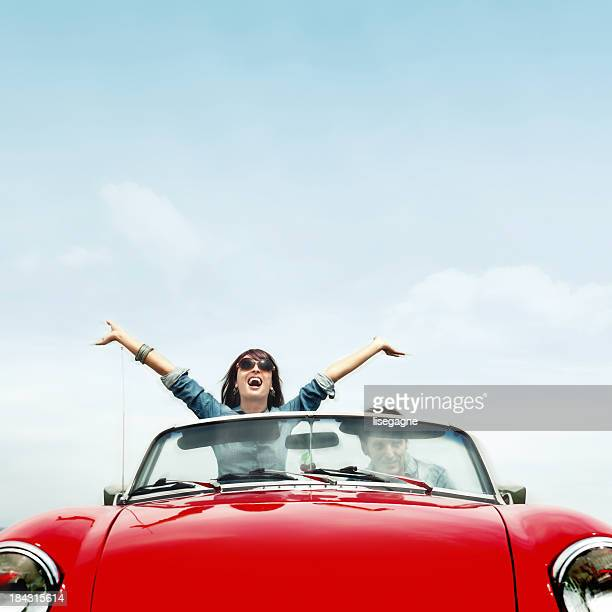 Couple in a red convertible
