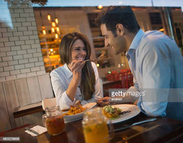 Couple in a romantic dinner at a restaurant