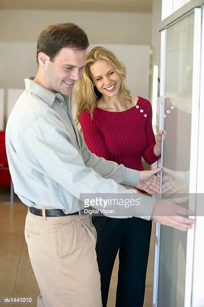 Couple in a Shop Examining a Sliding Door