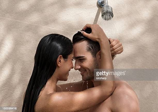 couple in a shower - couples showering stock pictures, royalty-free photos & images
