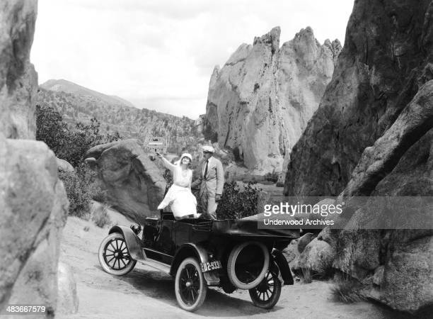 A couple in a silent short film from the Paramount Comedy Travels series Hollywood California late 1910s