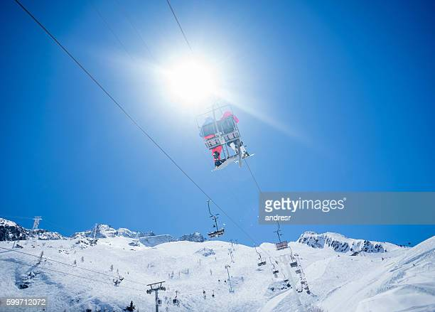 Couple in a ski lift chair