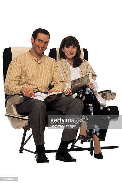 Couple in airplane seats
