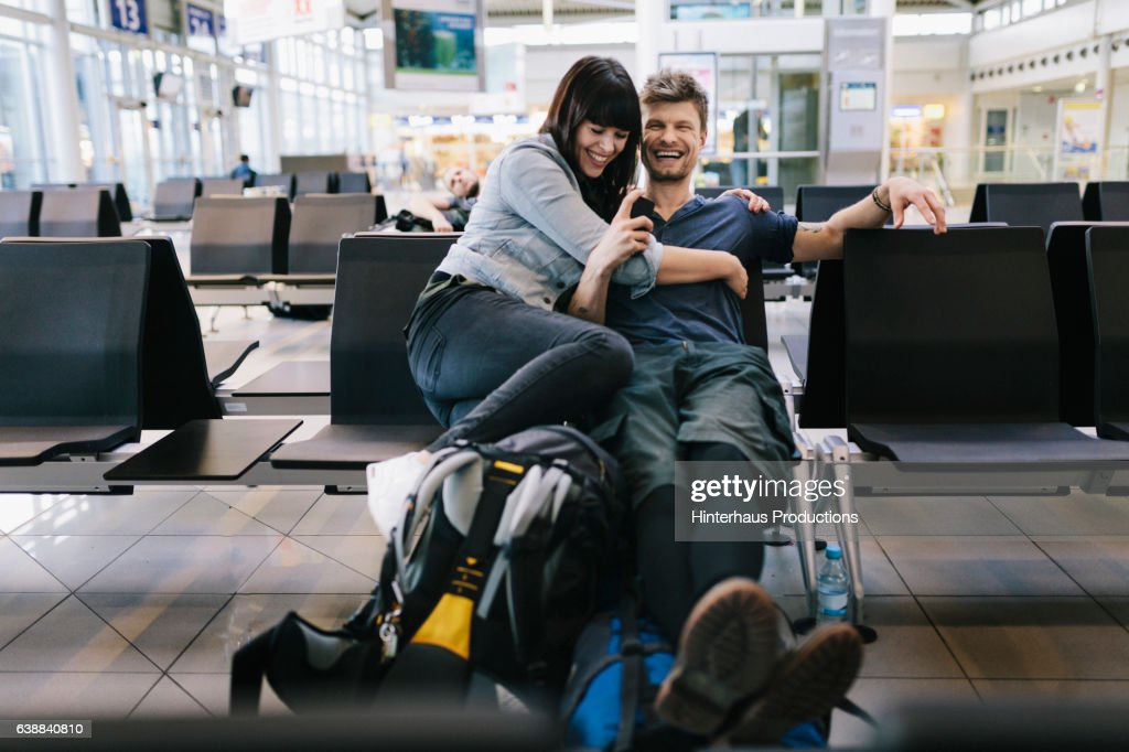 Couple in Airport departure lounge  : Stock Photo