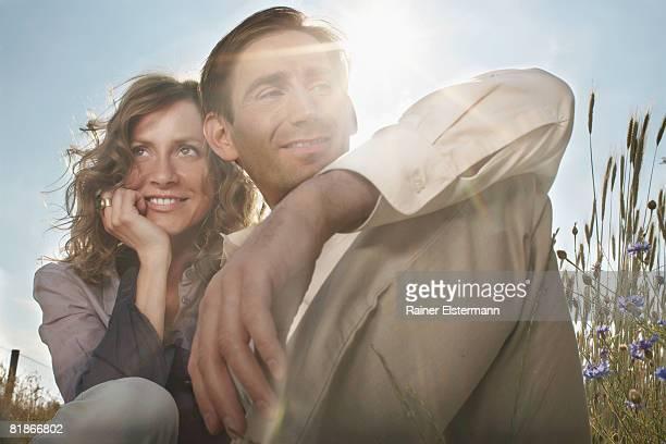 couple in an field