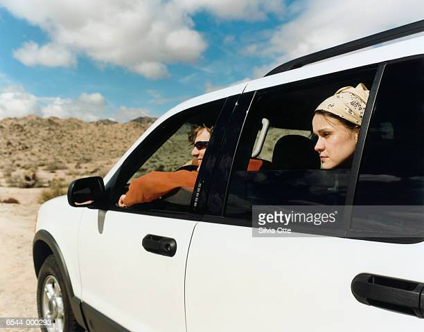 Couple in Automobile in Desert