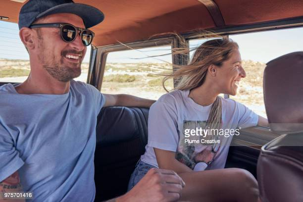 couple in back seat of car on road trip - adventure stock pictures, royalty-free photos & images