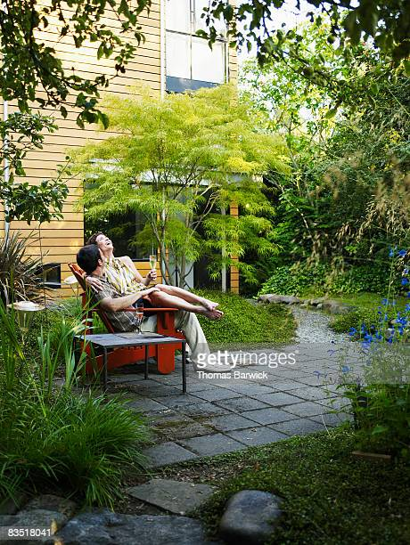Couple in backyard garden drinking champagne