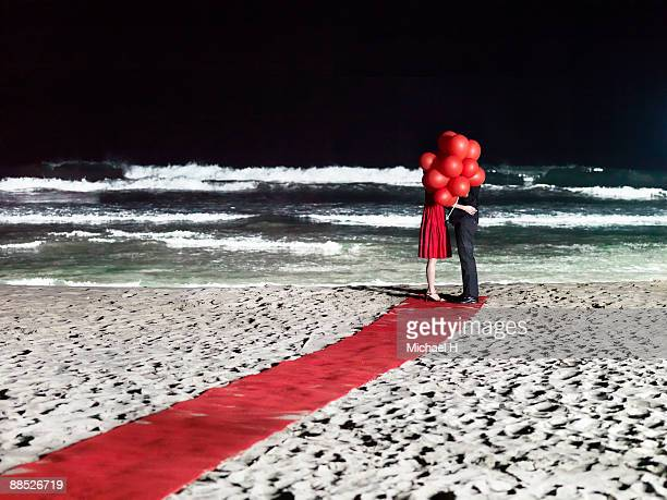 Couple in ballons on the beach